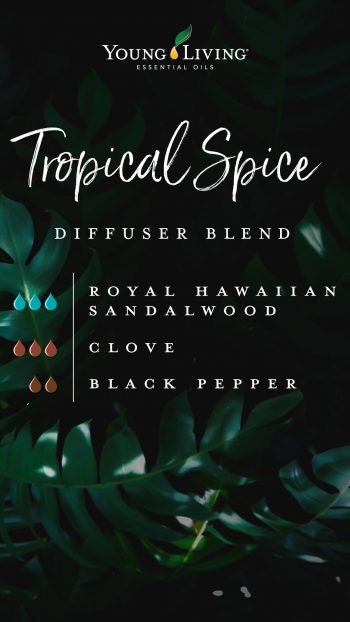 image of dark tropical leaves, text says Tropical Spice diffuser blend, 3 drops of royal hawaiian sandalwood essential oil, 3 drops of clove essential oil, 2 drops of black pepper essential oil